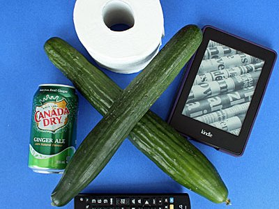 cucumbers,tv remote, kindle,can of ginger ale toilet paper